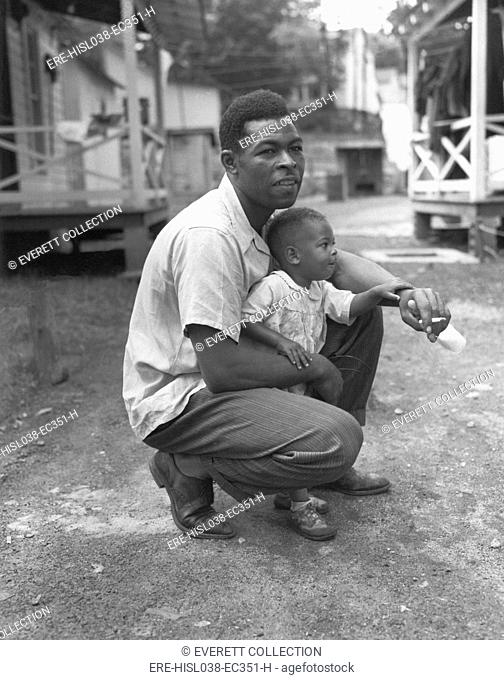 African American miner with his little boy. Grant Town, Marion County, West Virginia. June 13, 1946. Photo by Russell Lee. (BSLOC-2014-13-105)