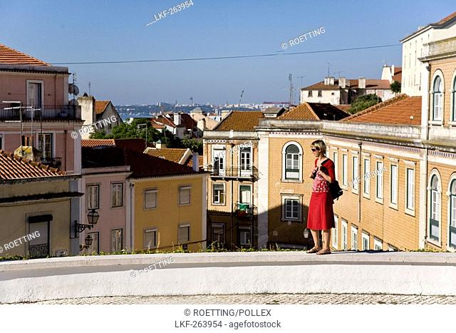 Young women above the roofs of Lisbon, MR, Lisbon, Portugal