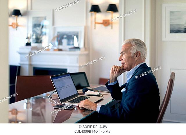 Businessman deep in thoughts in office