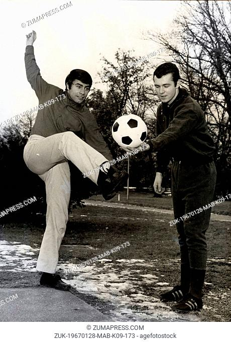 Jan. 28, 1967 - Munich, Germany - German pop singer and actor ROY BLACK (L) playing soccer at the park with soccer champion FRANZ BECKENBAUER (R)