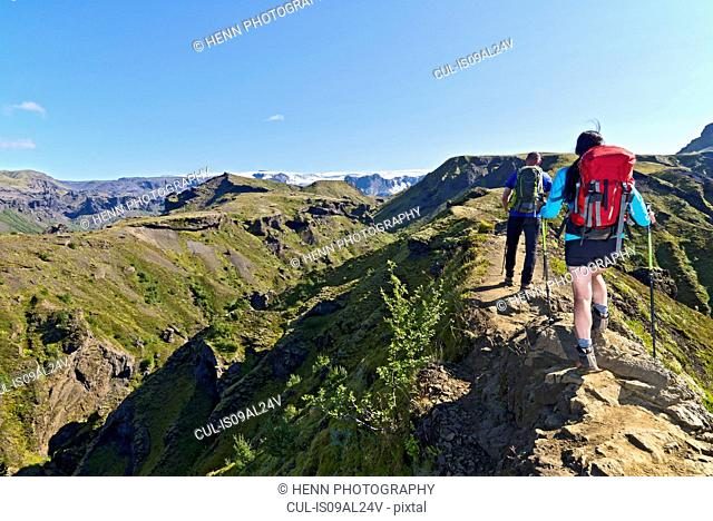 Couple hiking up to Fimmvordurhals Pass above Thorsmork Valley, Thorsmork, South Iceland, Iceland