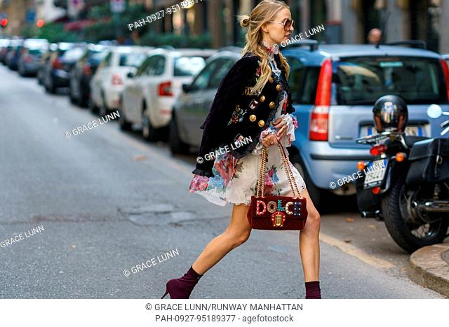 Blogger Leonie Hanne walking outside of the Dolce & Gabbana runway show during Milan Fashion Week - Sept 24, 2017 - Photo: Runway Manhattan/Grace Lunn ***For...