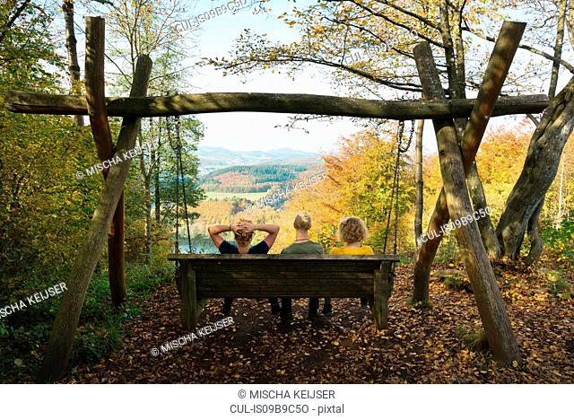 Family enjoying the view after hiking, Daun, Meerfeld, Rheinland-Pfalz, Germany