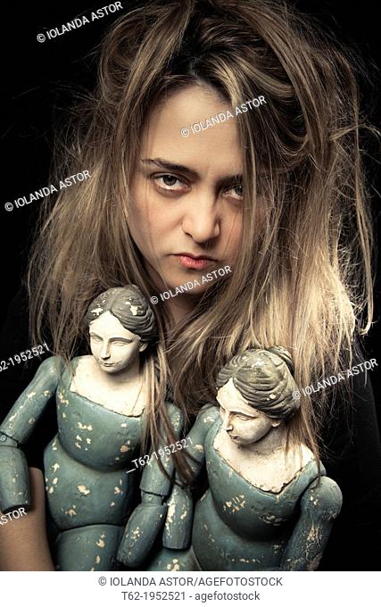 Madness. Woman and two old dolls