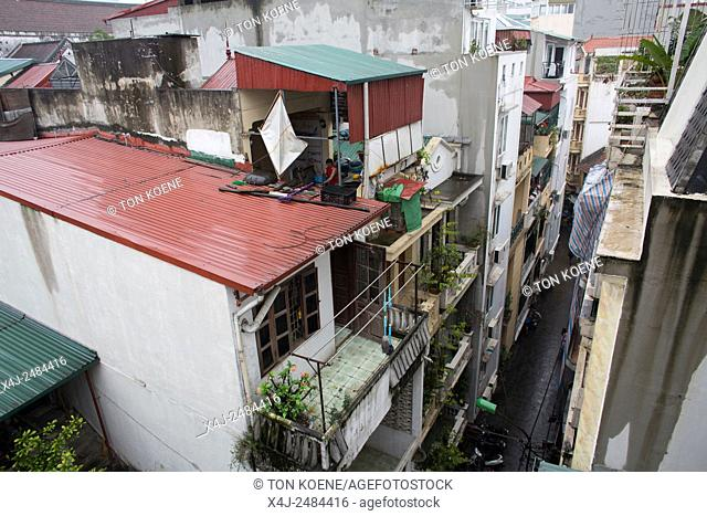 Narrow alleys and high-rise buildings in downtown Hanoi
