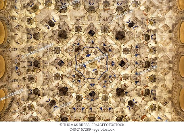 Highly artistic Moorish decoration at a ceiling in the Nasrid Palaces in the Alhambra palace. Granada, Granada province, Andalusia, Spain