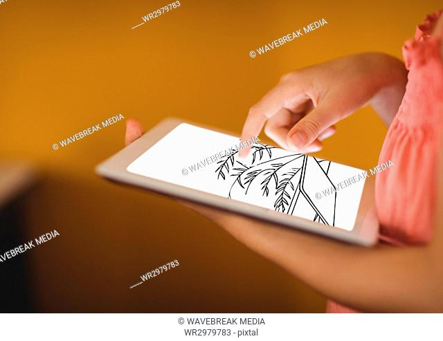hands with tablet with blueprint. In front of orange wall