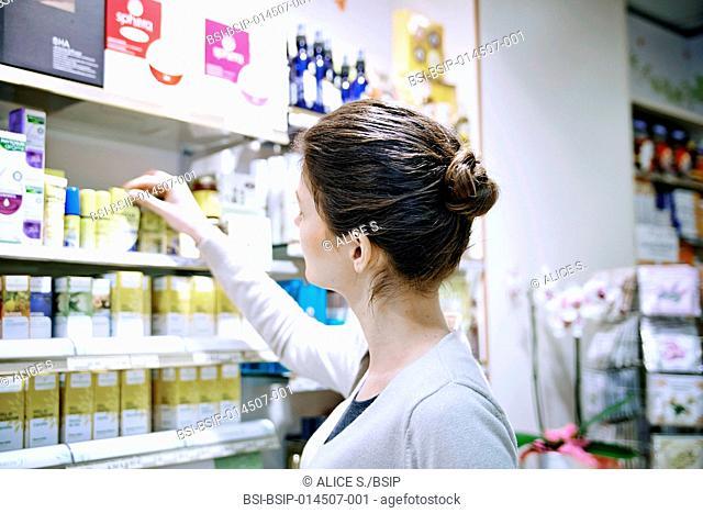 Woman choosing an essential oil