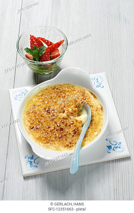 Crema catalana with almonds and strawberries (Spain)
