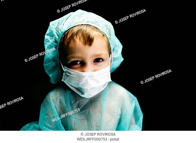 Portrait of little boy dressed up as doctor