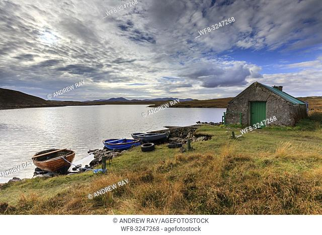 Loch Bhaltois on the Isle of Lewis in the Outer Hebrides, captured on an afternoon in . in late October with the moutains on North Harris in the distance