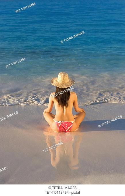 Woman sitting on beach