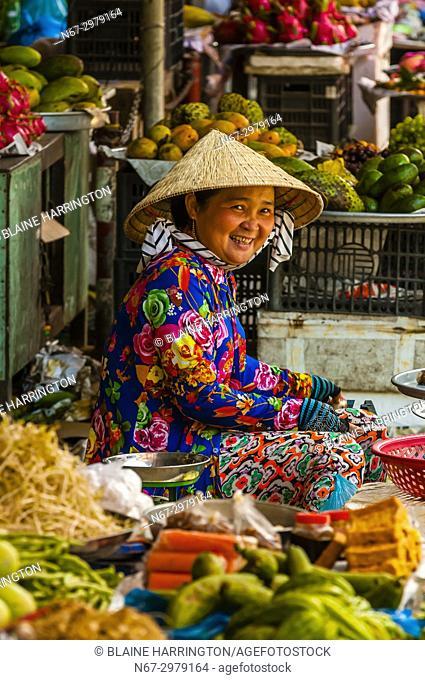 Woman at roadside vegetable market, near Cai Lay, Mekong Delta, Vietnam