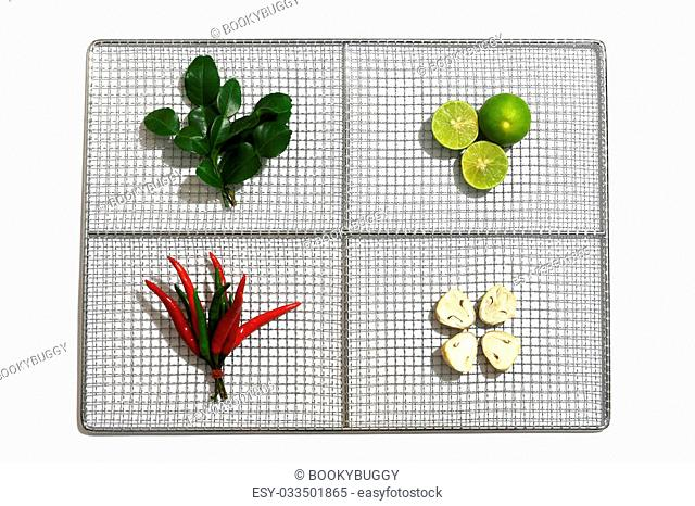 Fresh herbs and spices in a stainless plate on white background, Ingredients of Thai spicy food Tom Yum, Still life photography with ingredients