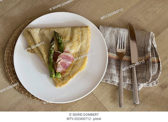 High angle view of pancake with asparagus served on plate
