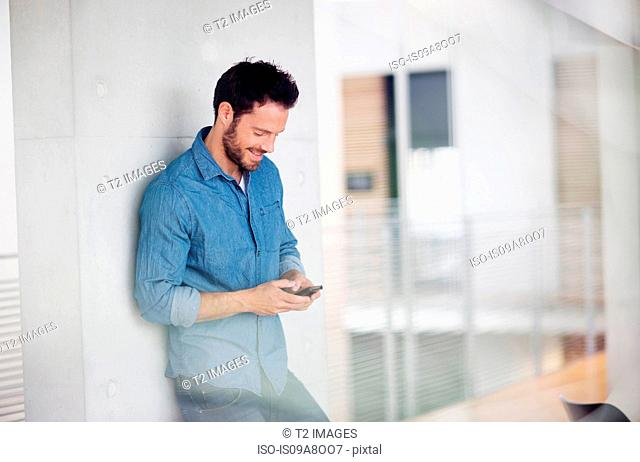 Man looking down at mobile phone