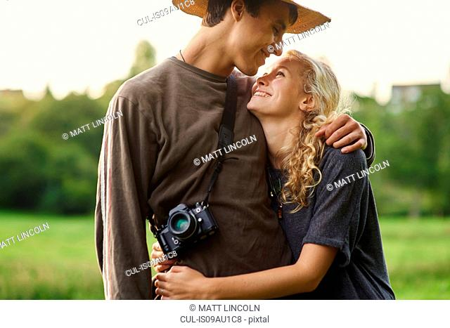 Romantic young couple in rural field