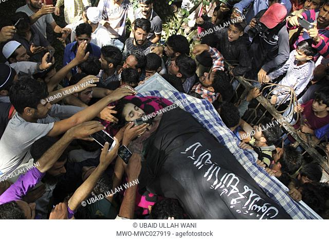 Kashmiri muslim mourners carry the body of Zahid Bhat of Nawdal Tral during his funeral procession August 09-2017.Thousands of people attend the funeral prayers...