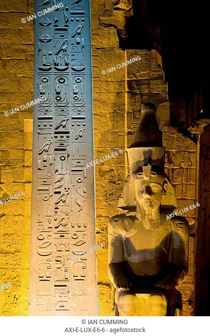 Detail of entrance to Luxor Temple with Obelisk and Colossus of Ramses II at dusk