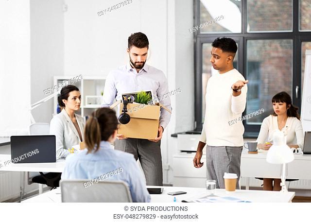 fired sad male office worker leaving