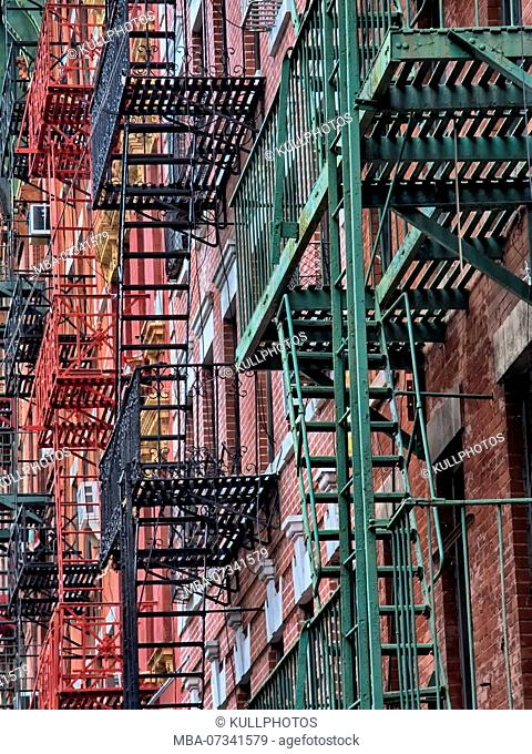 Fire exit stairs on typical New York brick buildings in Manhattan, New York City, USA