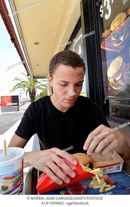An 18-year-old male eats fast food