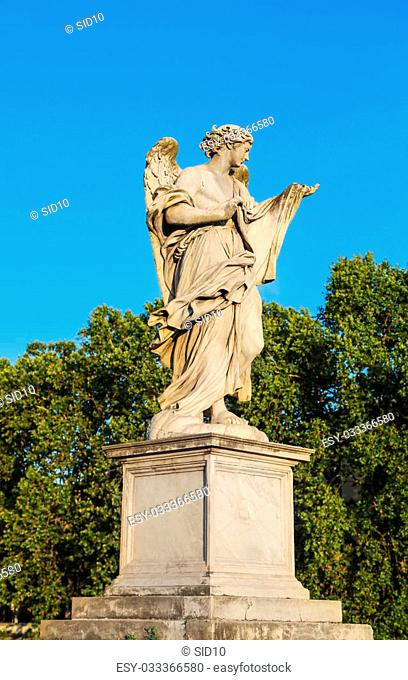 Ancient marble sculpture of angel on the Saint Angel Bridge. Rome, Italy