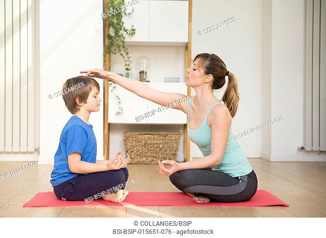 Mother and son practicing meditation