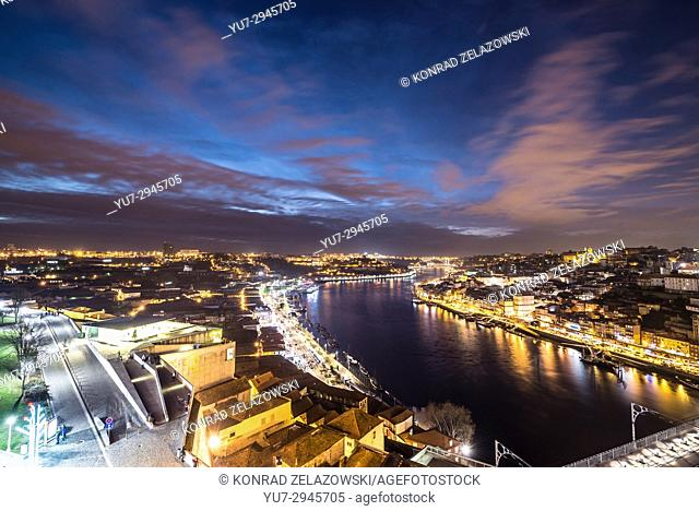 Evening sky over Douro River and cities of Porto (right) and Vila Nova de Gaia, Portugal. View with Caia Cable Car station