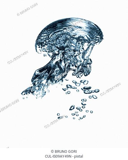 Transparent liquid and bubbles rising against white background