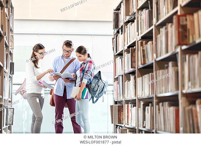 Two students at university library