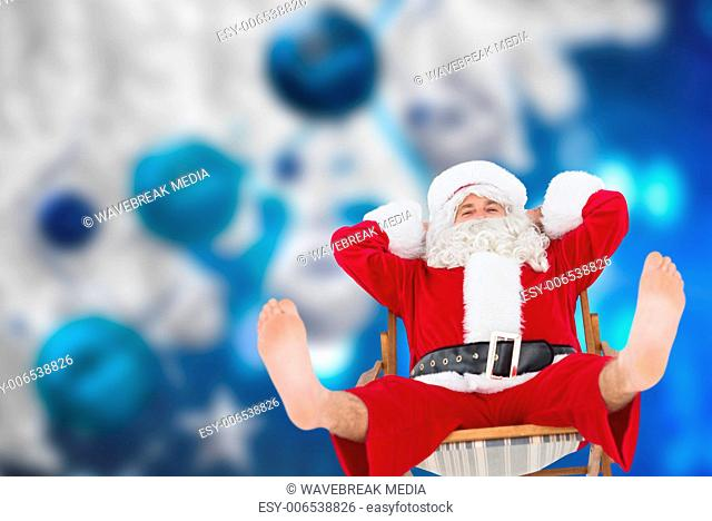 Composite image of relaxed santa stiting on deckchair