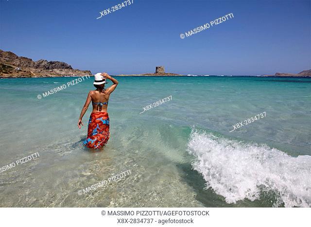 Woman at La Pelosa beach, Sardinia, Italy
