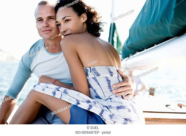 Young couple on yacht, hugging