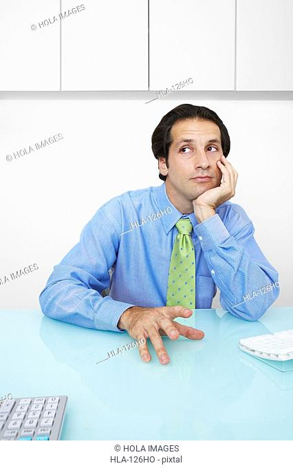 Businessman sitting in an office and thinking