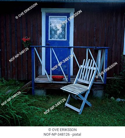 Folding chair in front of a door