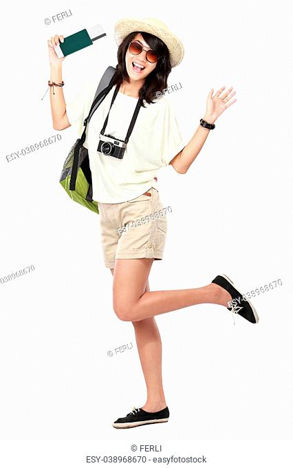 portrait of happy young girl bring backpack and pasport