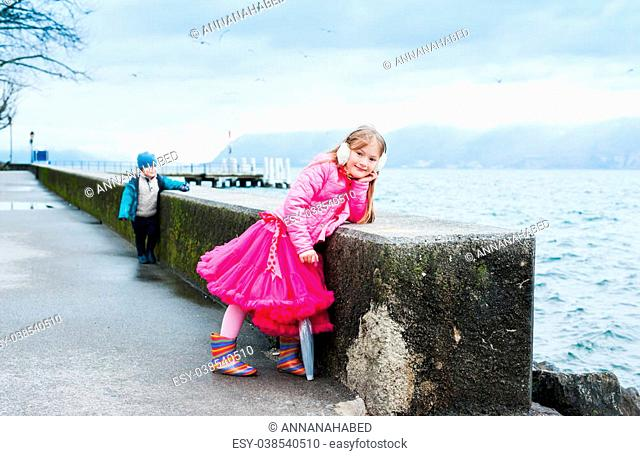 Outdoor portrait of a cute little girl on a cold day