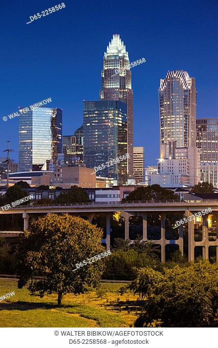 USA, North Carolina, Charlotte, elevated view of the city skyline from Route 74, dawn