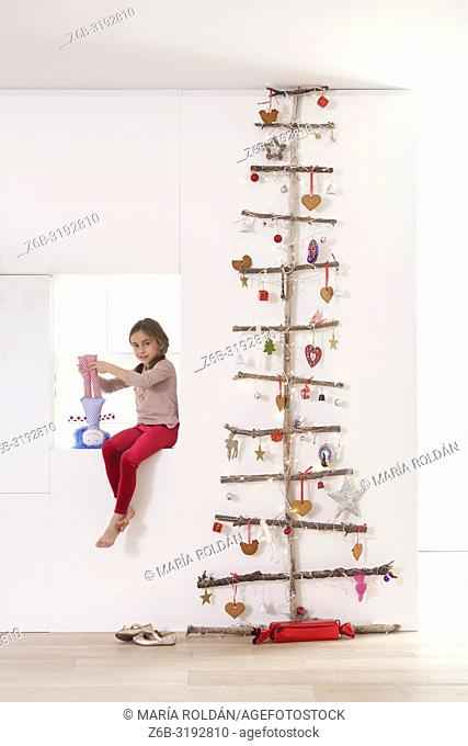 Unique Christmas tree and little girl