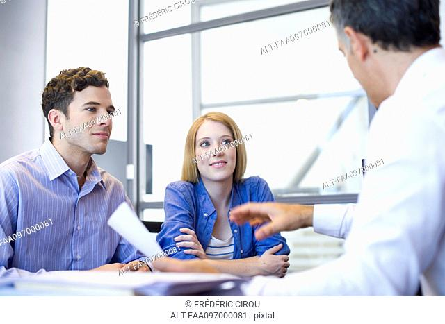 Clients meeting with advisor in office