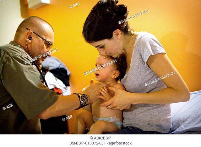 Reportage with a team from SOS Médecins emergency doctors based in Essonne in France. A home visit with a baby who has a sudden high temperature