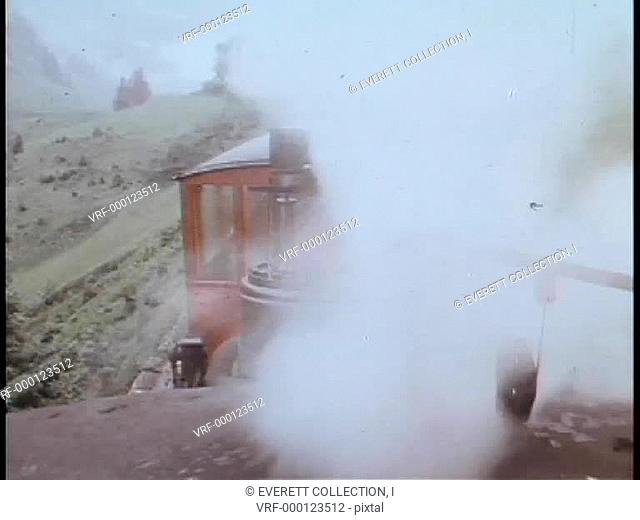 View from top of steam locomotive traveling through countryside