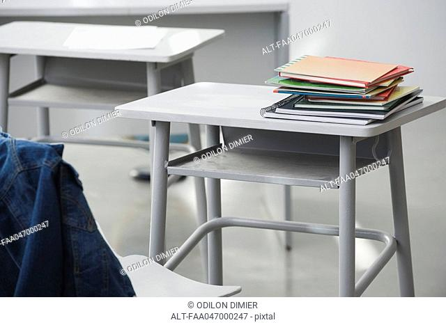 Books stacked on school desk