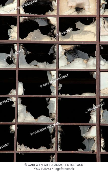 broken windows at derelict property in rome italy