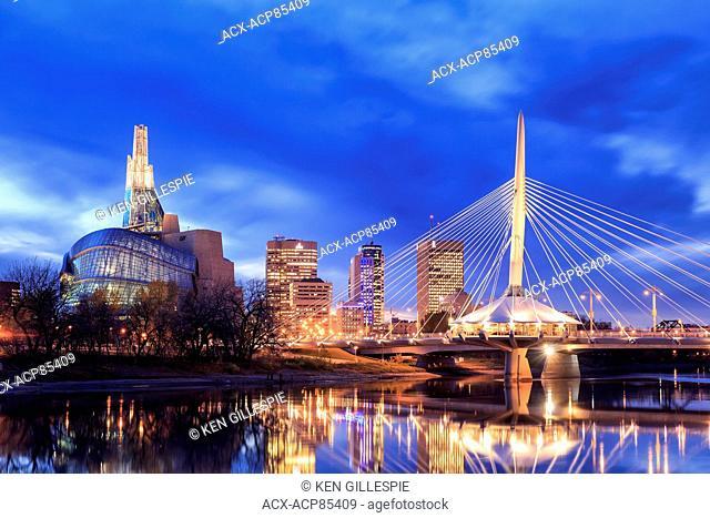 Winnipeg skyline at night with Canadian Museum for Human Rights and Esplanade Riel Bridge, Winnipeg, Manitoba, Canada