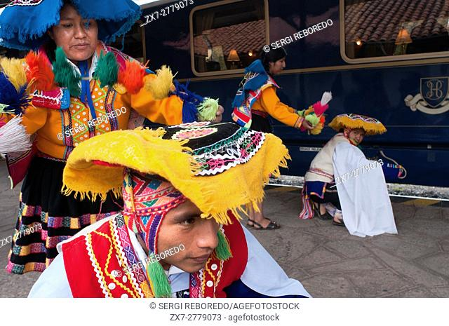 Peru Luxury train from Cuzco to Machu Picchu. Orient Express. Belmond. Musicians and dancers in traditional costumes brighten up the entry in the Hiram Bingham...