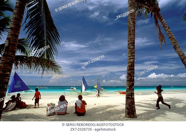 Landscape with palm trees. Bankas in White beach. Boracay. Philippines. Boracay is a small island in the Philippines located approximately 315km (196mi)...