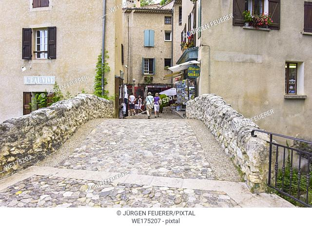 stone bridge of the village Moustiers-Sainte-Marie, Provence, France, houses at stone bridge, member of most beautiful villages of France
