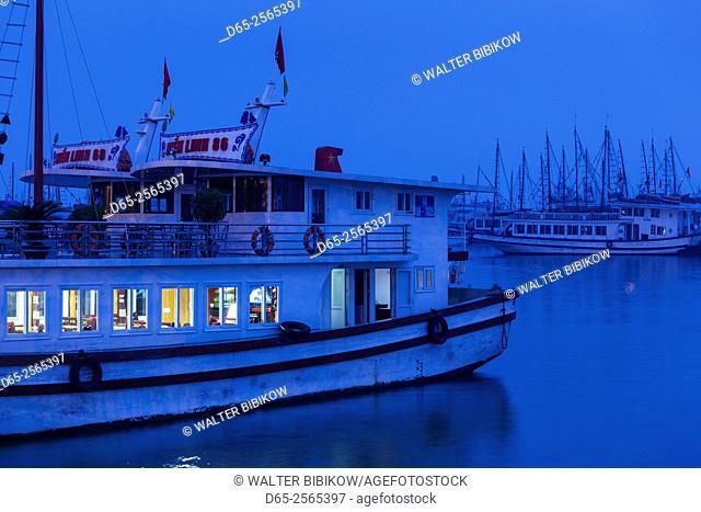 Vietnam, Halong City, Bai Chay port, Halong Bay tourist boats, dusk
